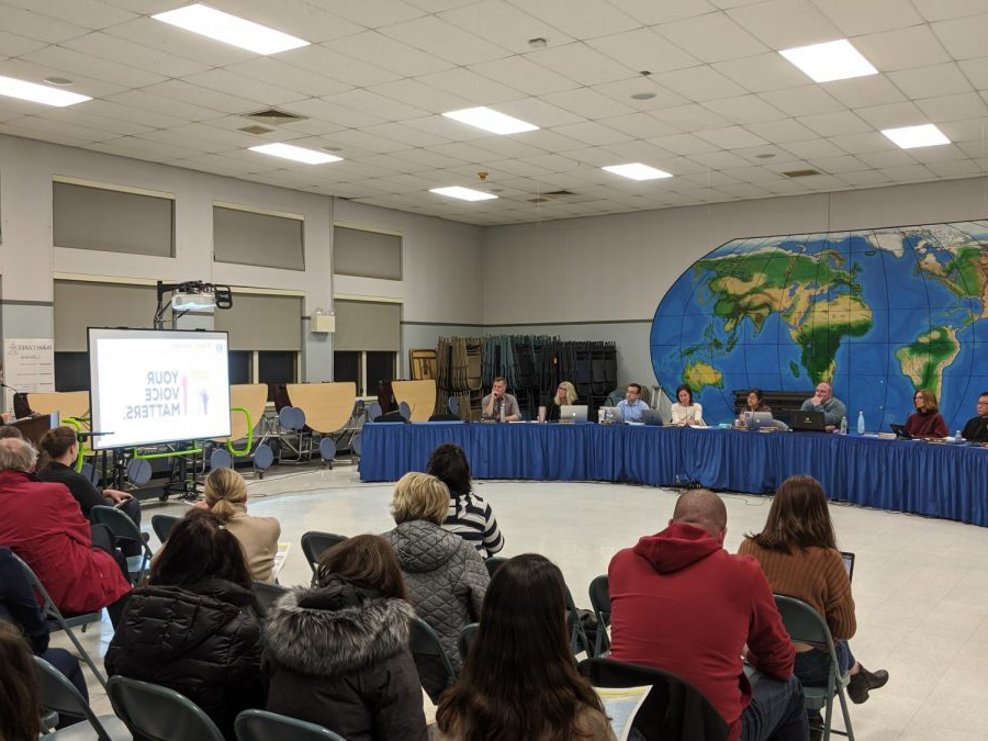 The+Hamilton-Wenham+School+Committee+and+members+of+school+administration+hear+comments+from+community+members+on+the+school+budget.+%0AFrom+Left+to+Right%3A+Gene+Lee%2C+Michelle+Horgan%2C+David+Polito%2C+Michelle+Bailey%2C+Julie+Kukenberger%2C+Vincent+Leone%2C+Stacey+Metternick%2C+and+Peter+Wolczik.+Not+pictured+but+present%3A+Tai+Pryjma.